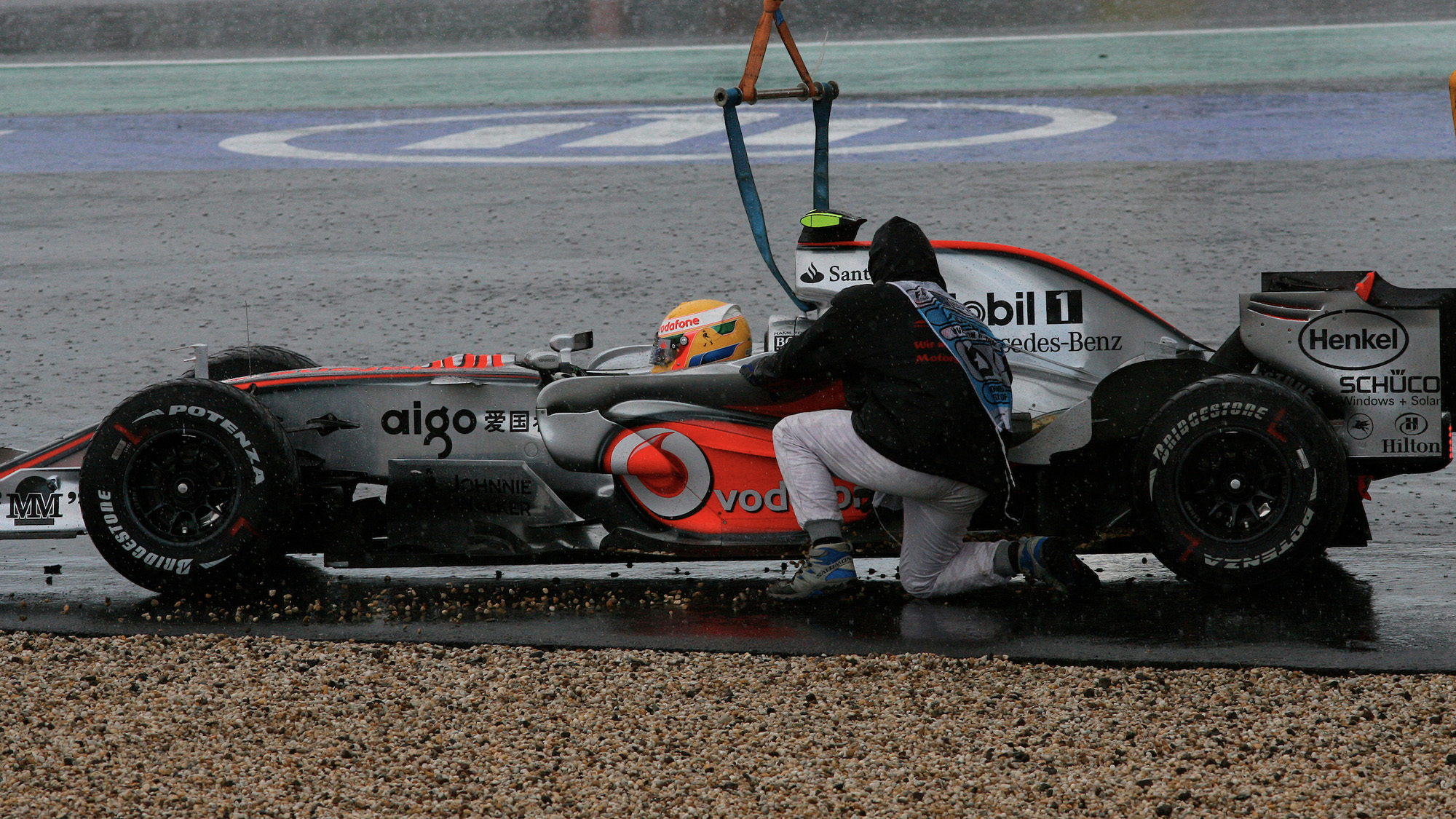 Lewis Hamilton rejoins the 2007 European Grand Prix at the Nurburgring after going off and being lifted out of the gravel by a crane