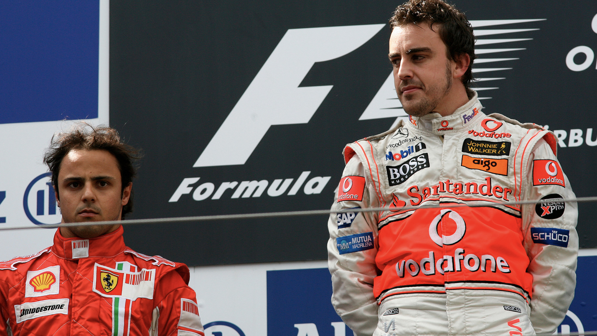 Fernando Alonso and Felipe Massa on the podium at the 2007 GErman Grand Prix at the Nurburgring