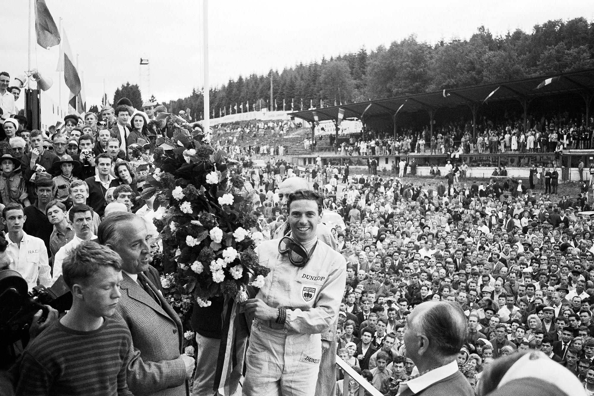 Jim Clark on the podium after winning the 1964 Belgian Grand Prix.