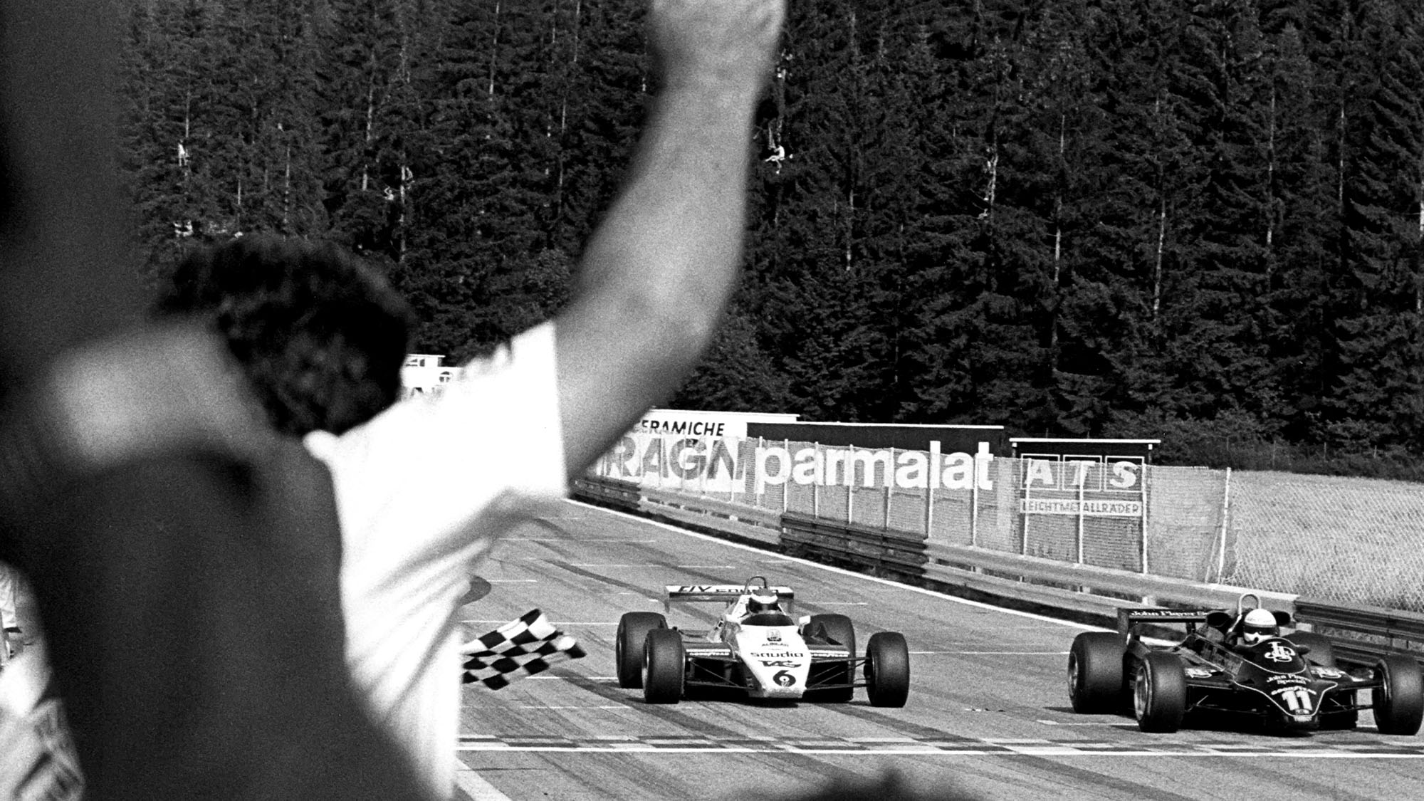 Elio de Angelis, Keke Rosberg, Lotus-Ford 91, Williams-Ford FW08, Grand Prix of Austria, Red Bull Ring, Spielberg, Austria, August 15, 1982. Elio de Angelis crosses the finish line just ahead of Keke Rosberg, and takes victory. (Photo by Bernard Cahier/Getty Images)