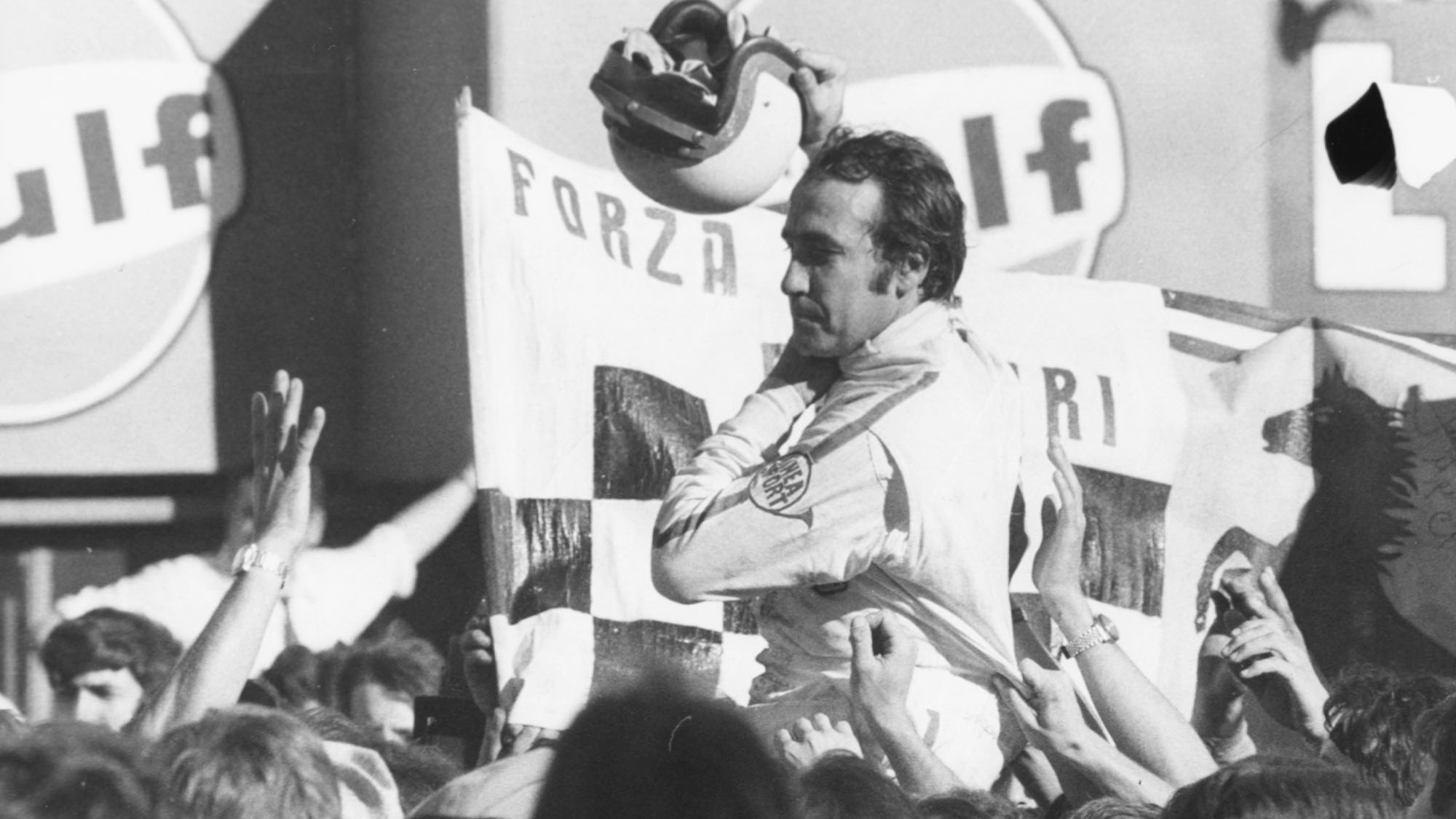 Swiss racing driver Clay Regazzoni is grabbed by members of the crowd after winning the Italian Grad Prix at Monza, September 8th 1970. (Photo by Keystone/Hulton Archive/Getty Images)