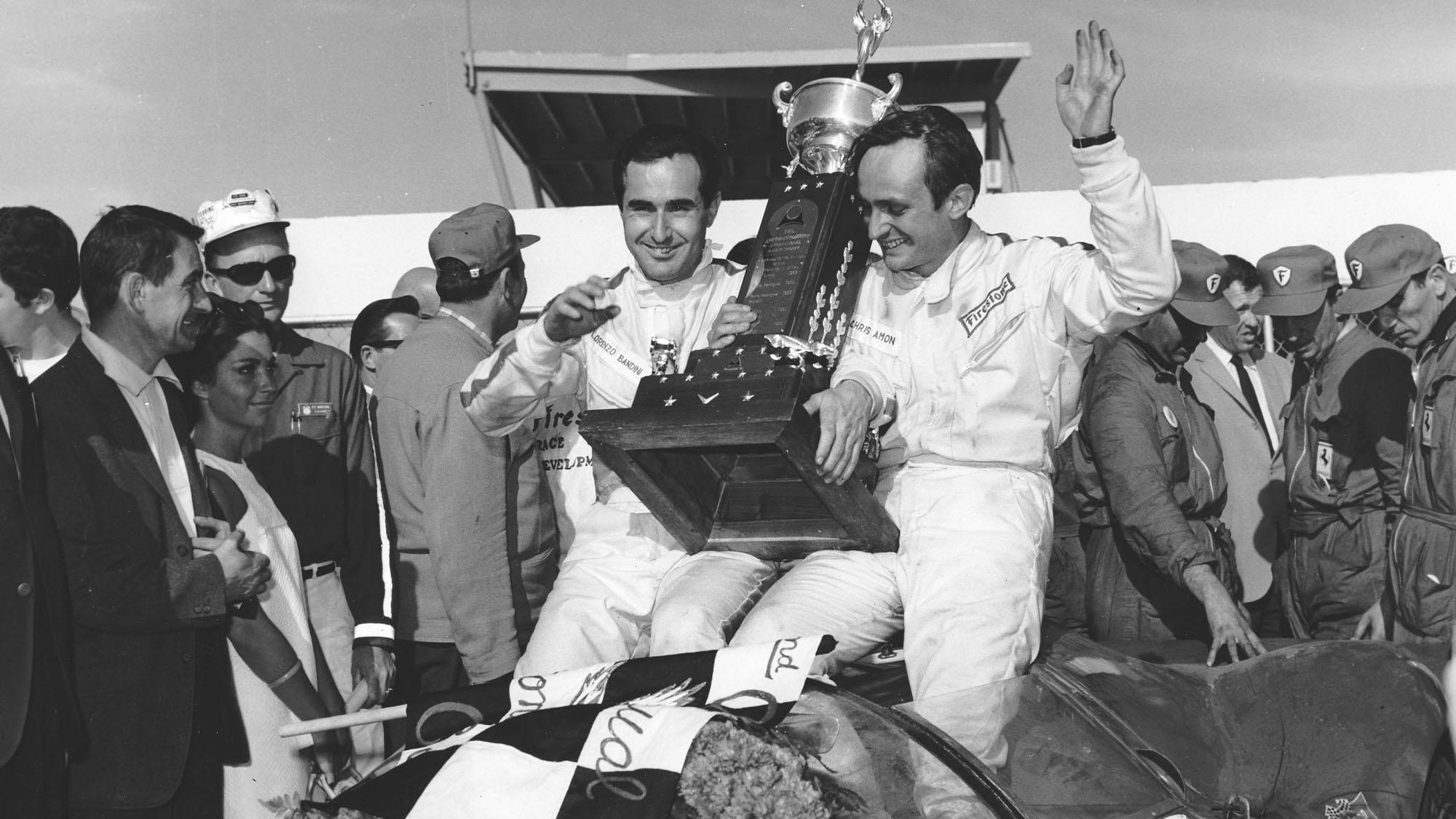 DAYTONA BEACH, FL - FEBRUARY 5, 1967: Lorenzo Bandini and Chris Amon celebrate in victory lane after driving a Ferrari 330 P4 to victory in the 24 Hour Daytona Continental at Daytona International Speedway. (Photo by ISC Images & Archives via Getty Images)
