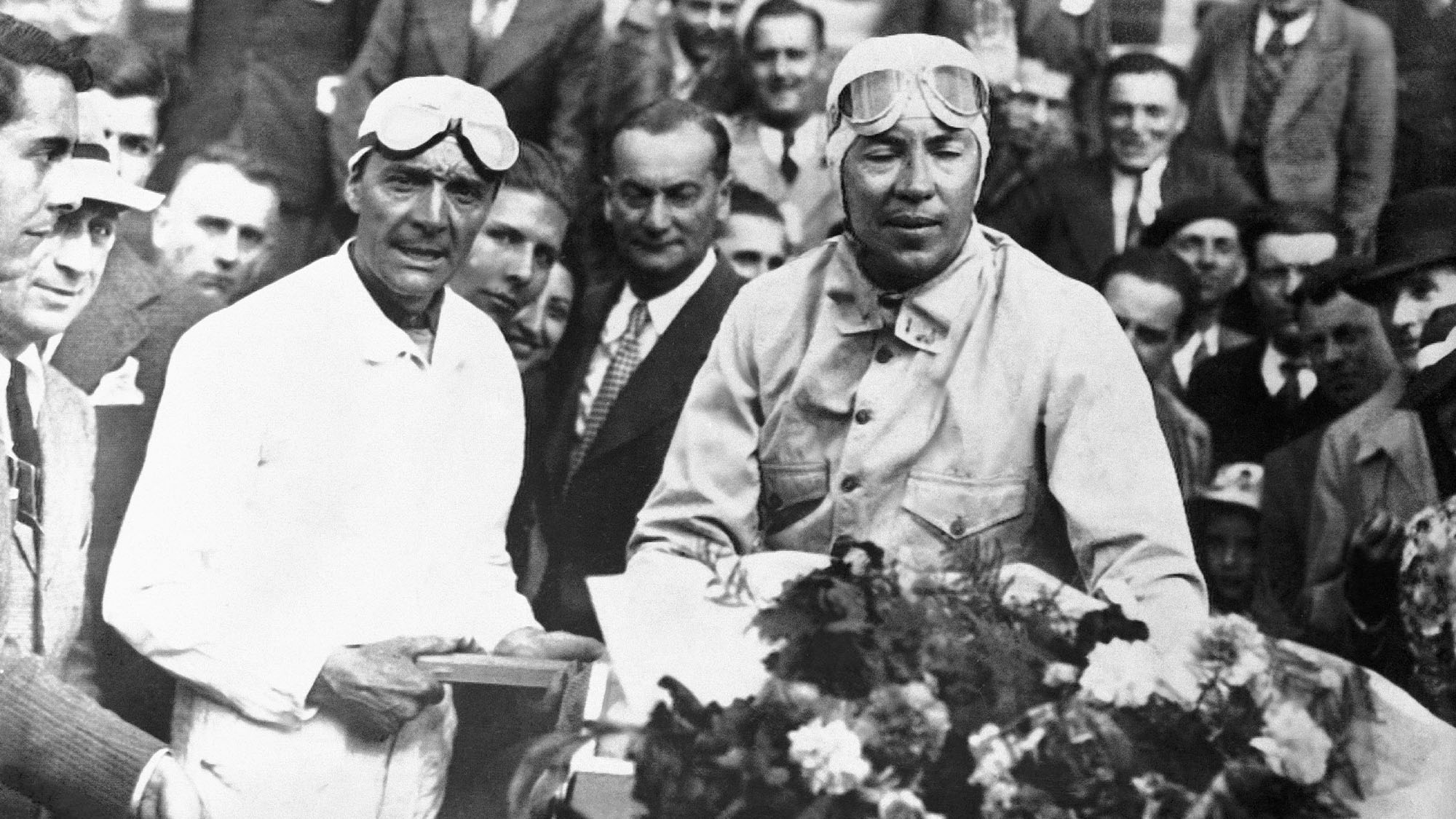 FRANCE - JANUARY 18: The racing drivers Robert BENOIST and Jean-Pierre WIMILLE receive flowers for their victory at the 24h of Le Mans, on June 20, 1937. (Photo by Keystone-France/Gamma-Keystone via Getty Images)
