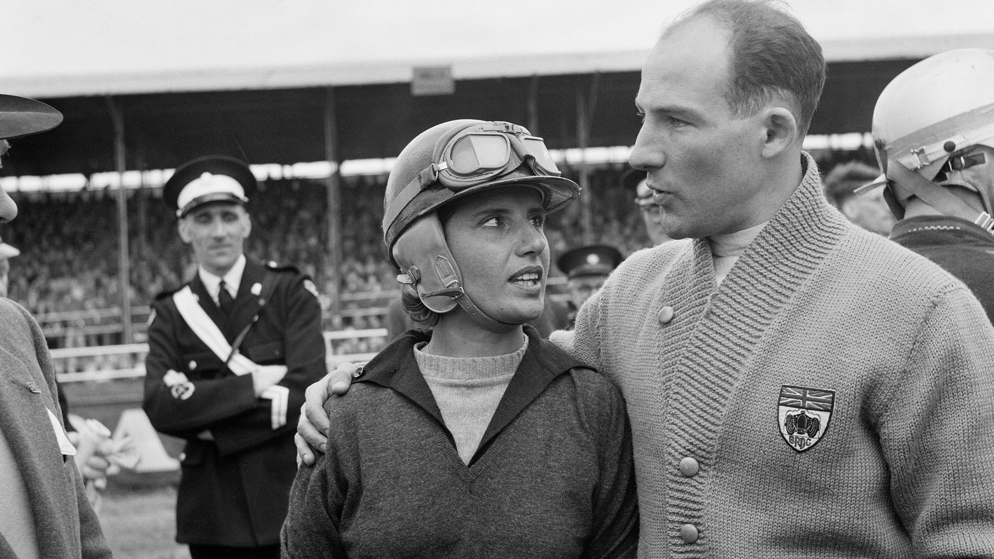 Maria Teresa de Filippis with Stirling Moss at SIlverstone in 1959
