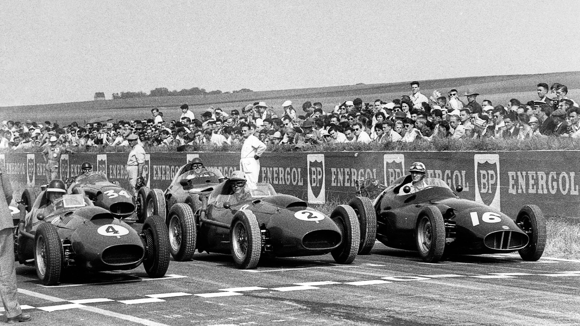 Mike Hawthorn, Luigi Musso, Harry Schell, Ferrari Dino 246, BRM P25, Grand Prix of France, Reims, 06 July 1958. (Photo by Bernard Cahier/Getty Images)