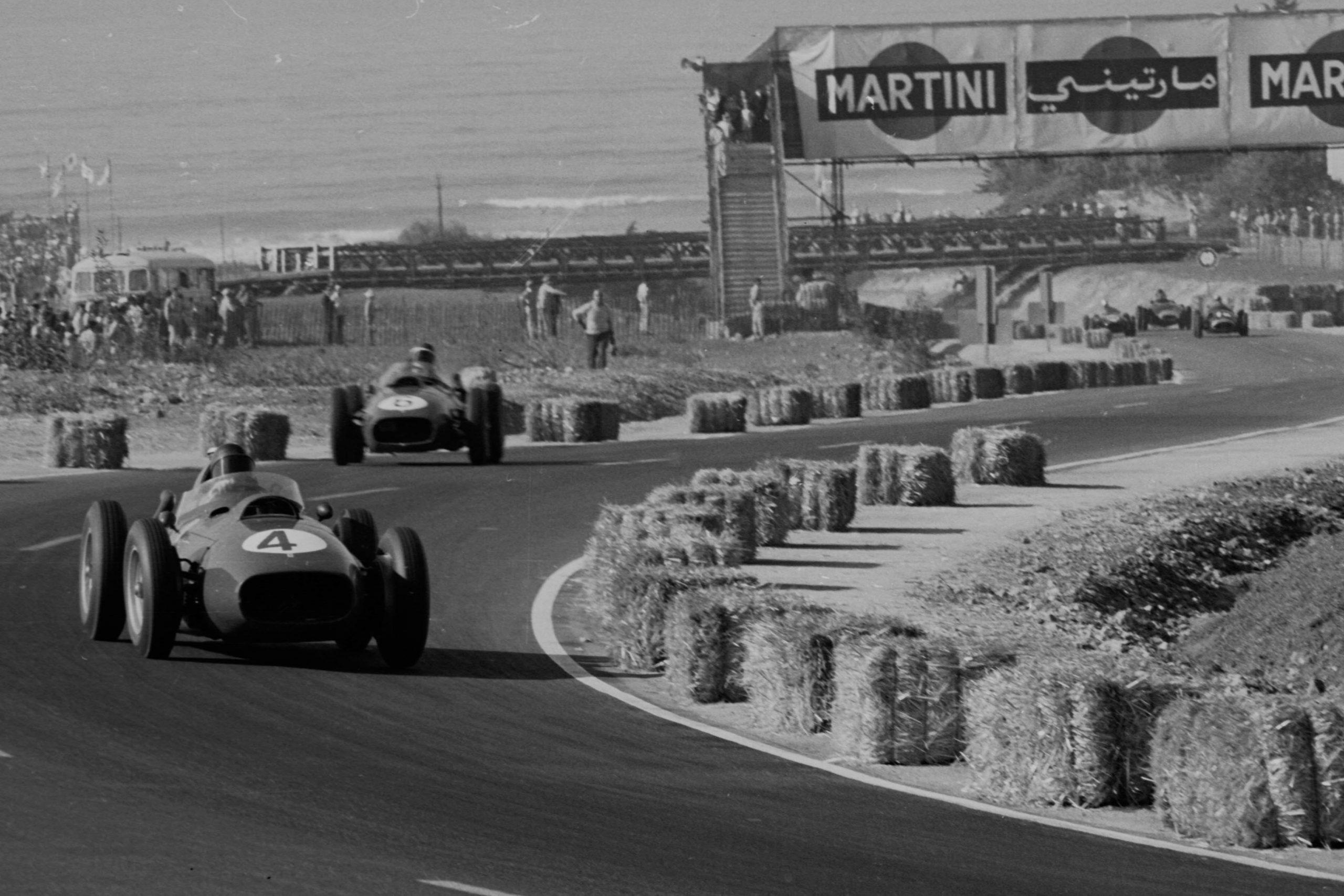 Phil Hill leads Mike Hawthorn in Ferrari Dino 246's.