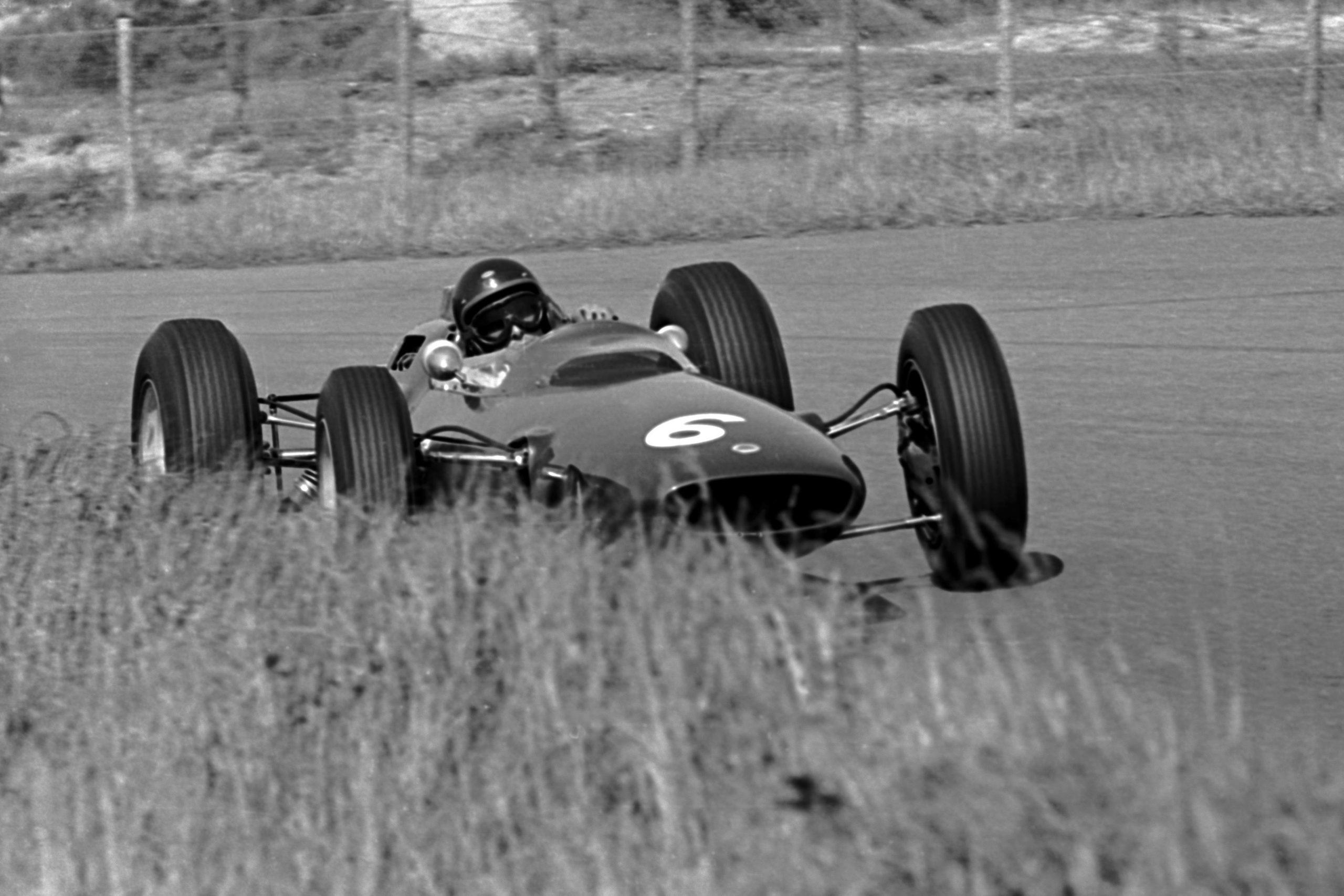 Jim Clark pushing his Lotus 25.