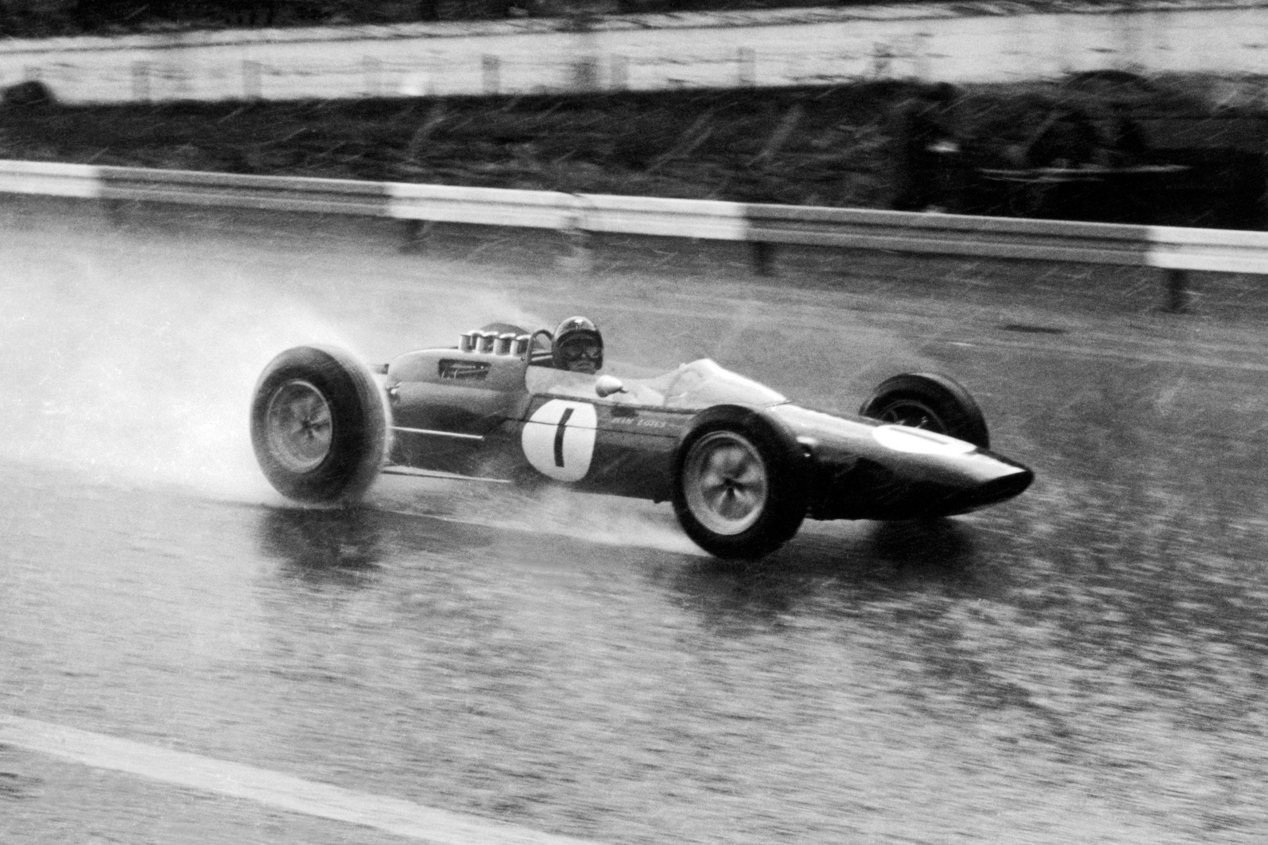 Jim Clark pressing on through the rain in his Lotus 25-Climax.
