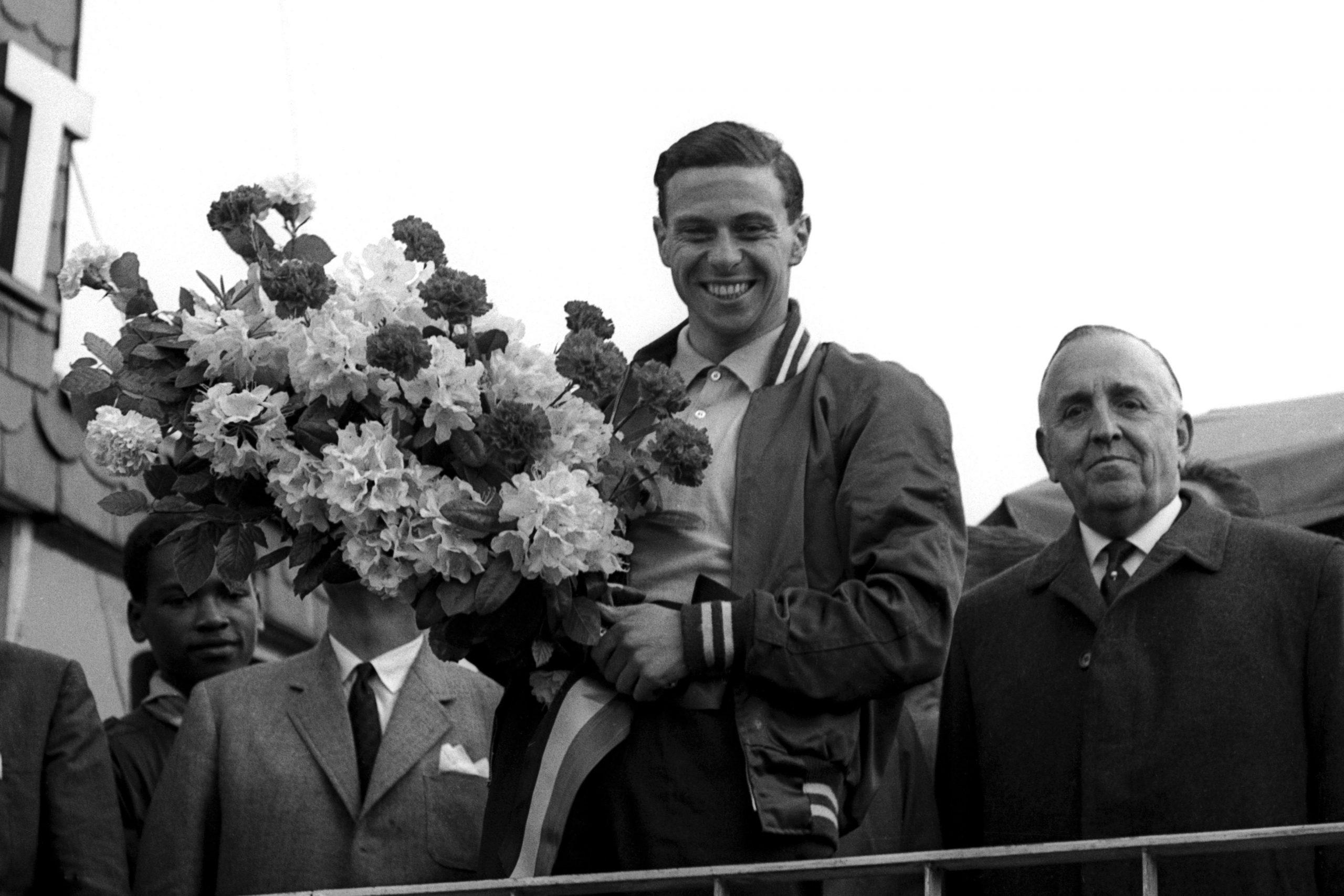 Race winner Jim Clark celebrates victory on the podium.