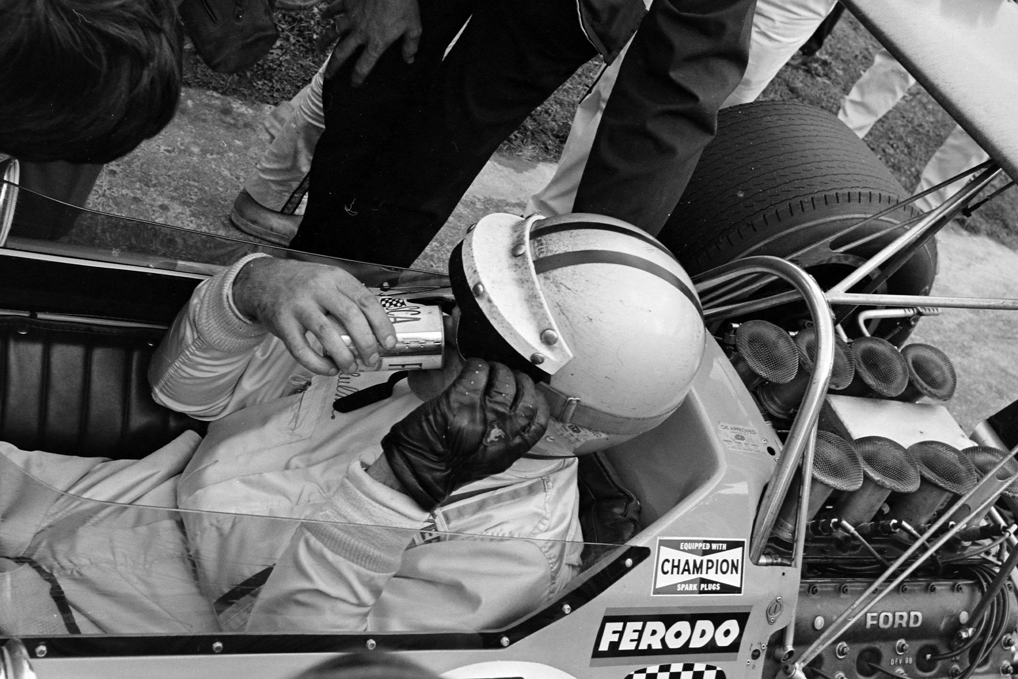 Denny Hulme takes a drink after winning the 1968 Canadian Grand Prix.