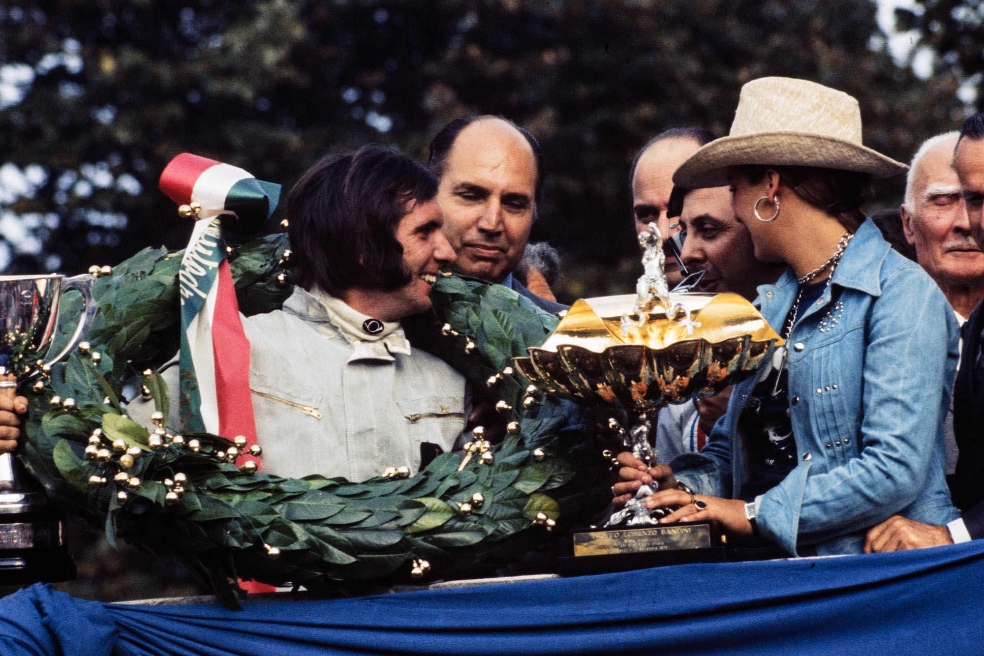 Emerson Fittipaldi receives the winner's trophy on the podium at the 1972 Italian Grand Prix, Monza.