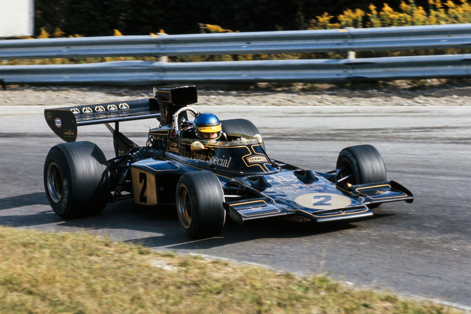 Ronnie Peterson shows typical commitment as he drives his Lotus at Mosport Park during the 1973 Canadian Grand Prix.
