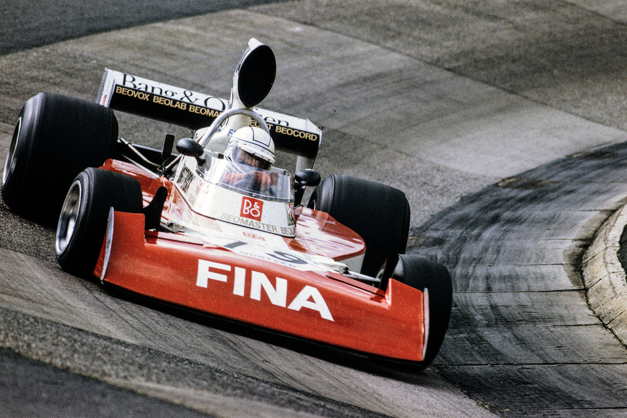 Jochen Mass drives through the Karussell in his Surtees at the 1974 German Grand Prix, Nurburgring.