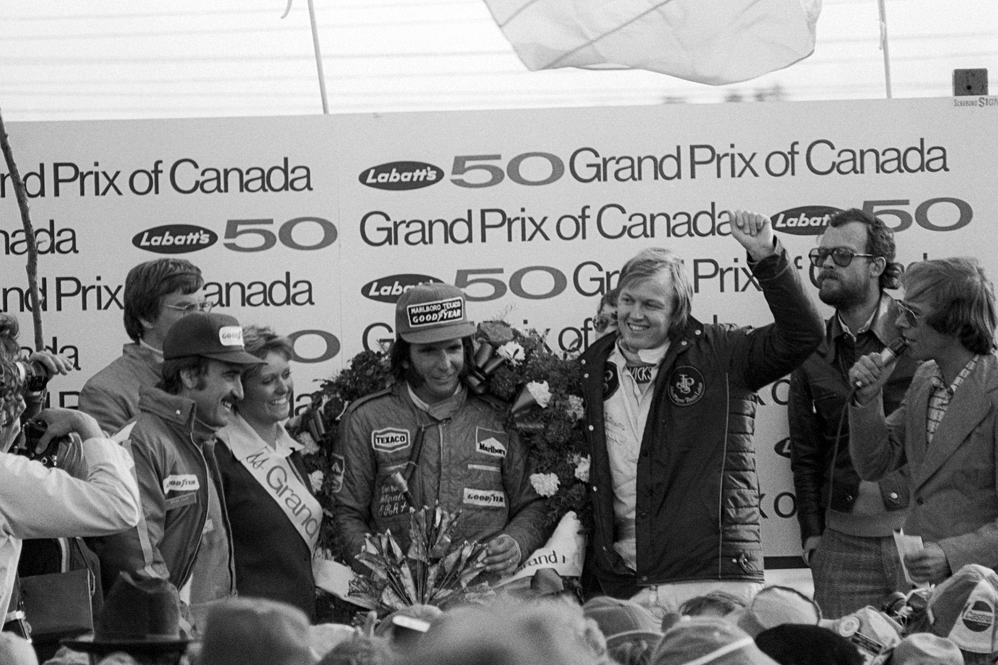 Emerson Dittipaldi celebrates winning the 1974 Canadian Gran Prix, Mosport.