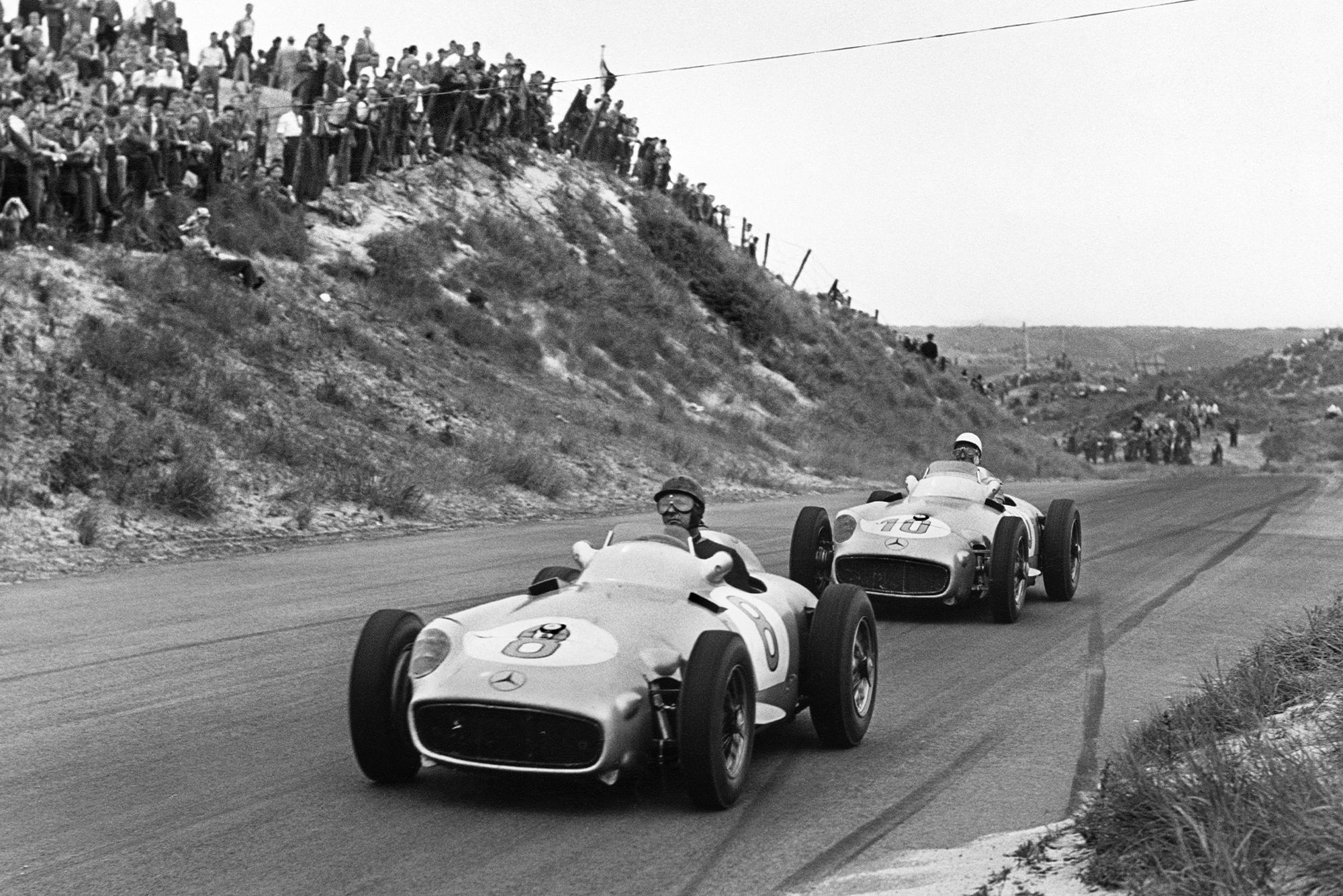Juan Manuel Fangio (Mercedes-Benz W196),1st position, leads Stirling Moss (Mercedes-Benz W196), 2nd position at the 1955 Dutch Grand Prix, Zandvoort.