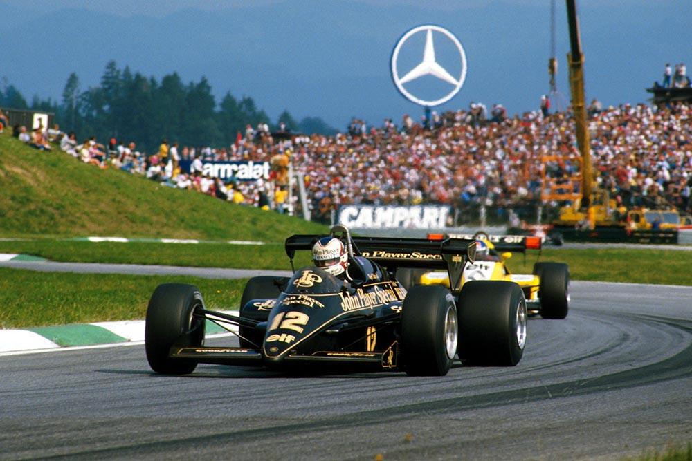 Ayrton Senna's Toleman, leading Elio de Angelis in his Lotus.