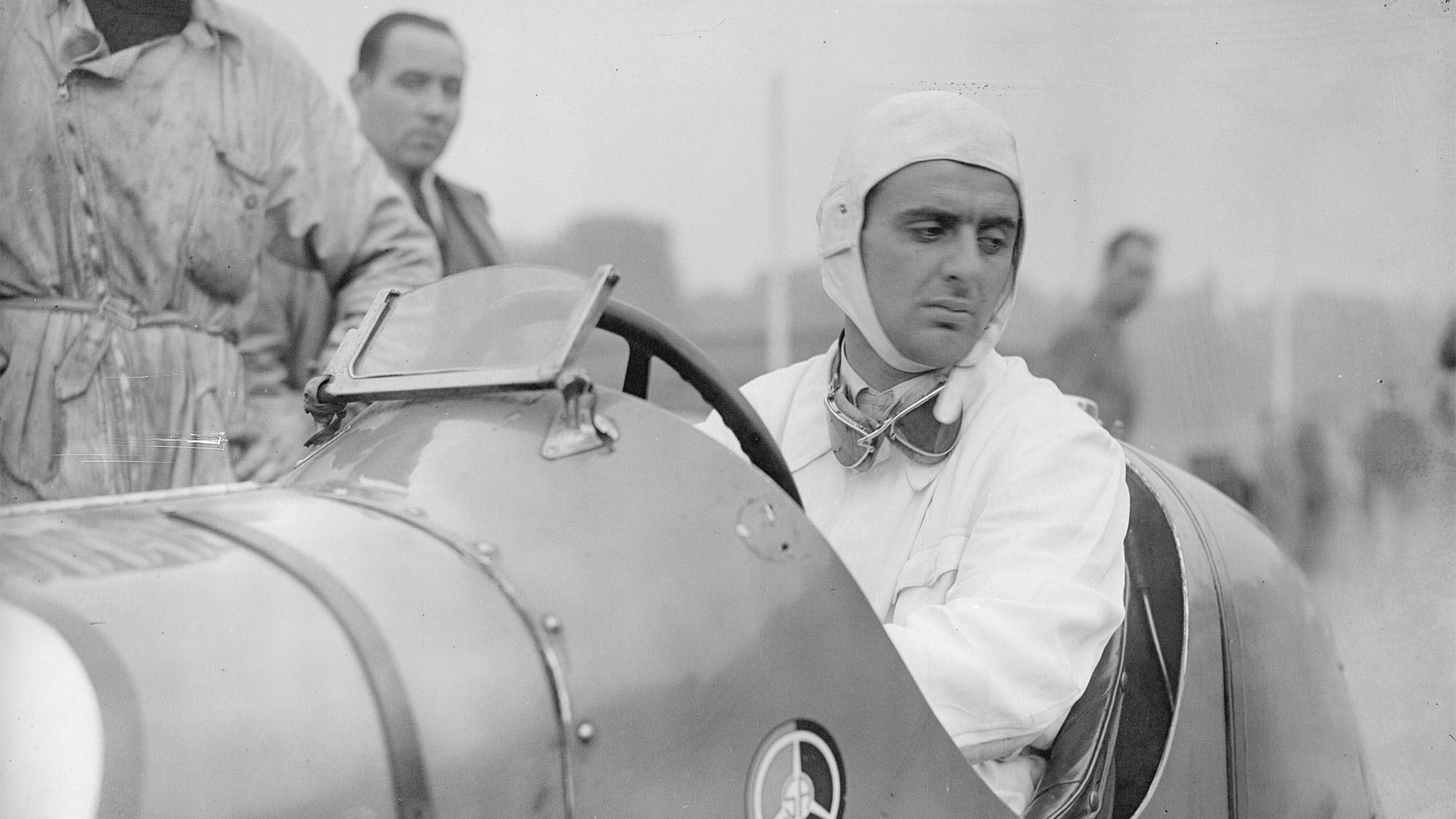 Italian racing driver Luigi Villoresi (1909 - 1997) sits in his Maserati whilst preparations continue for Britain's first international car race at Crystal Palace. (Photo by David Savill/Getty Images)