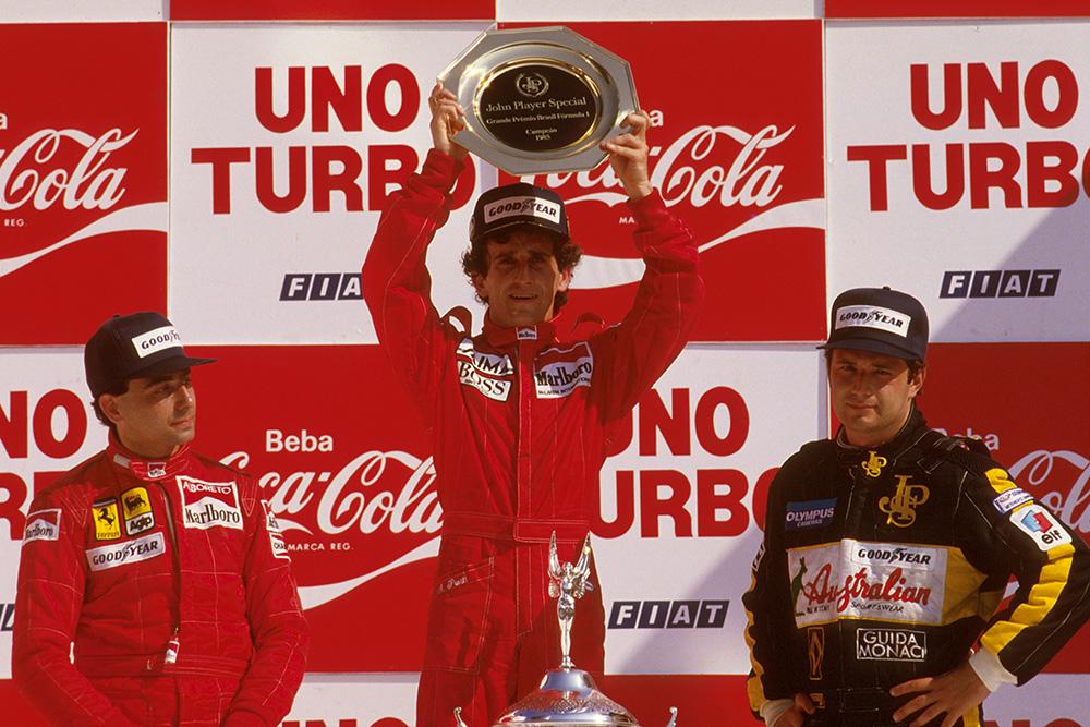 Alain Prost, 1st position, Michele Alboreto, 2nd position and Elio de Angelis, 3rd position on the podium.