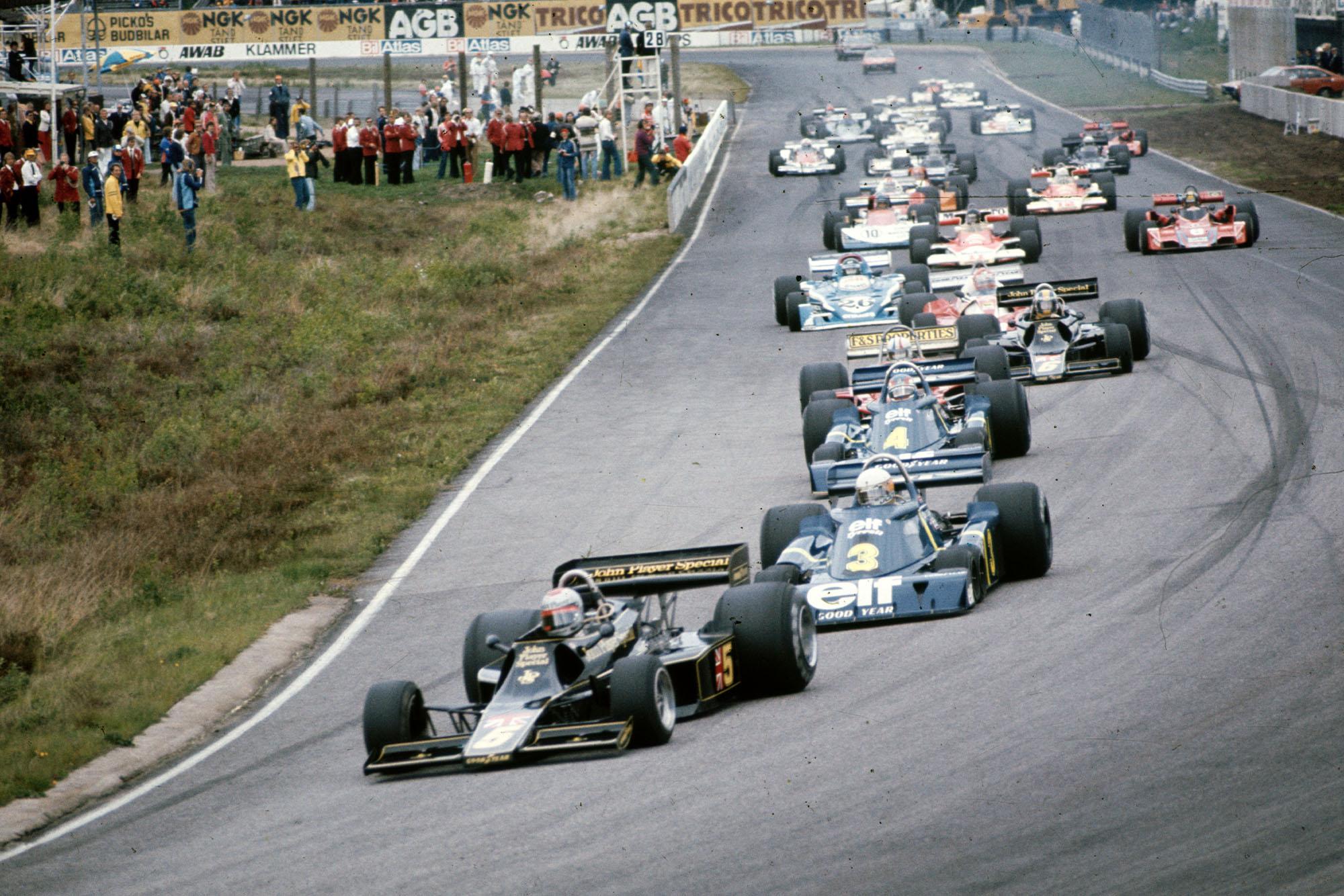 Mario Andretti (Lotus) leads at the start of the 1976 Swedish Grand Prix.