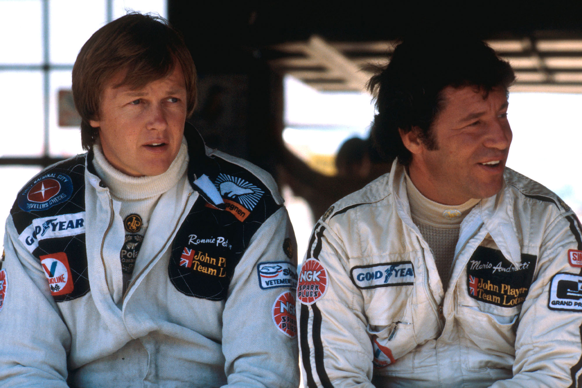 Ronnie Peterson (left) sits next to Mario Andretti at the 1978 Italian Grand Prix, Monza.
