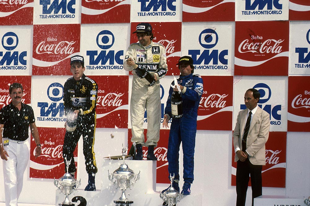 Ayrton Senna, 2nd; Nelson Piquet 1st and Jacques Laffite3rd on the podium.