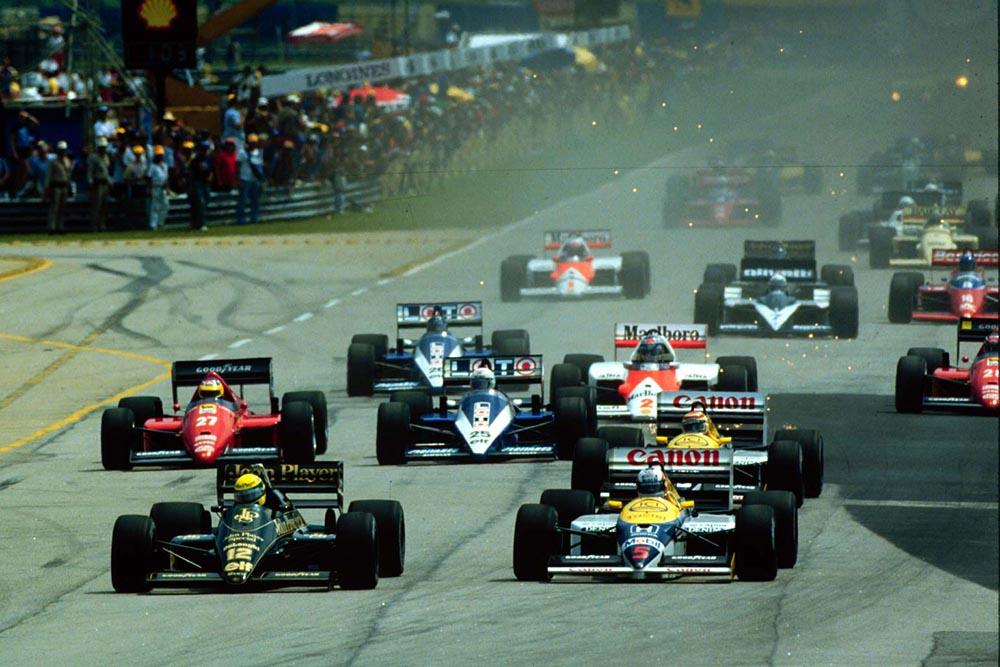 Ayrton Senna just leads Nigel Mansell.