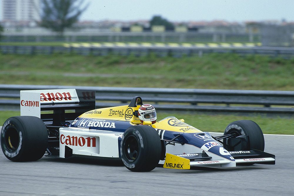 Nelson Piquet at the heel of his Williams FW11 Honda.