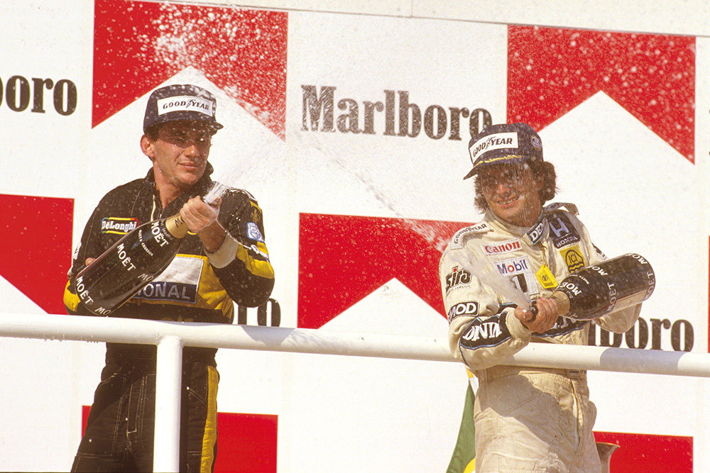 Nelson Piquet, 1st position, with Ayrton Senna, 2nd position on the podium.