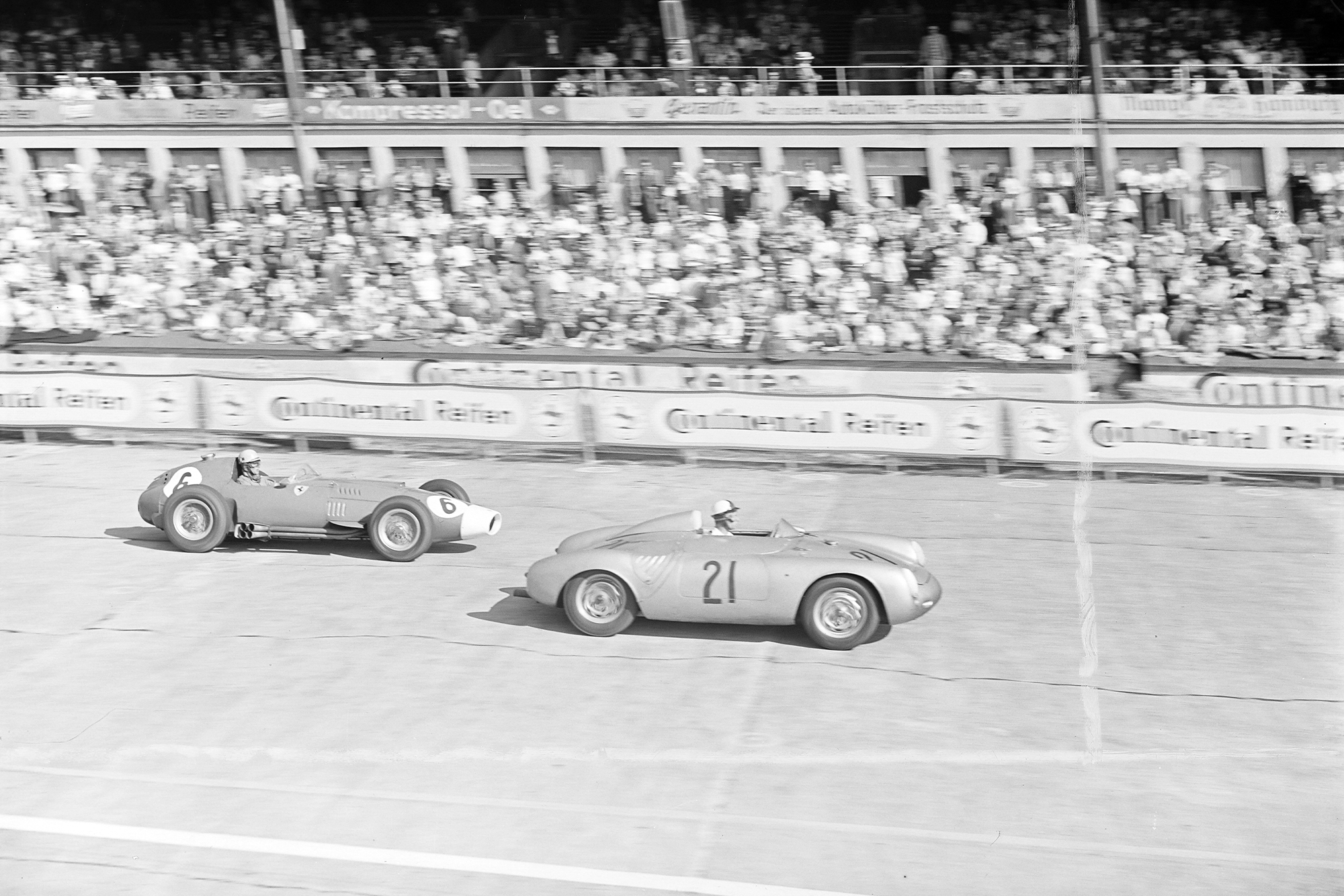 Edgar Barth, Porsche 550RS, leads Luigi Musso, Ferrari D50, during the 1957 German Grand Prix, Nurburgring.