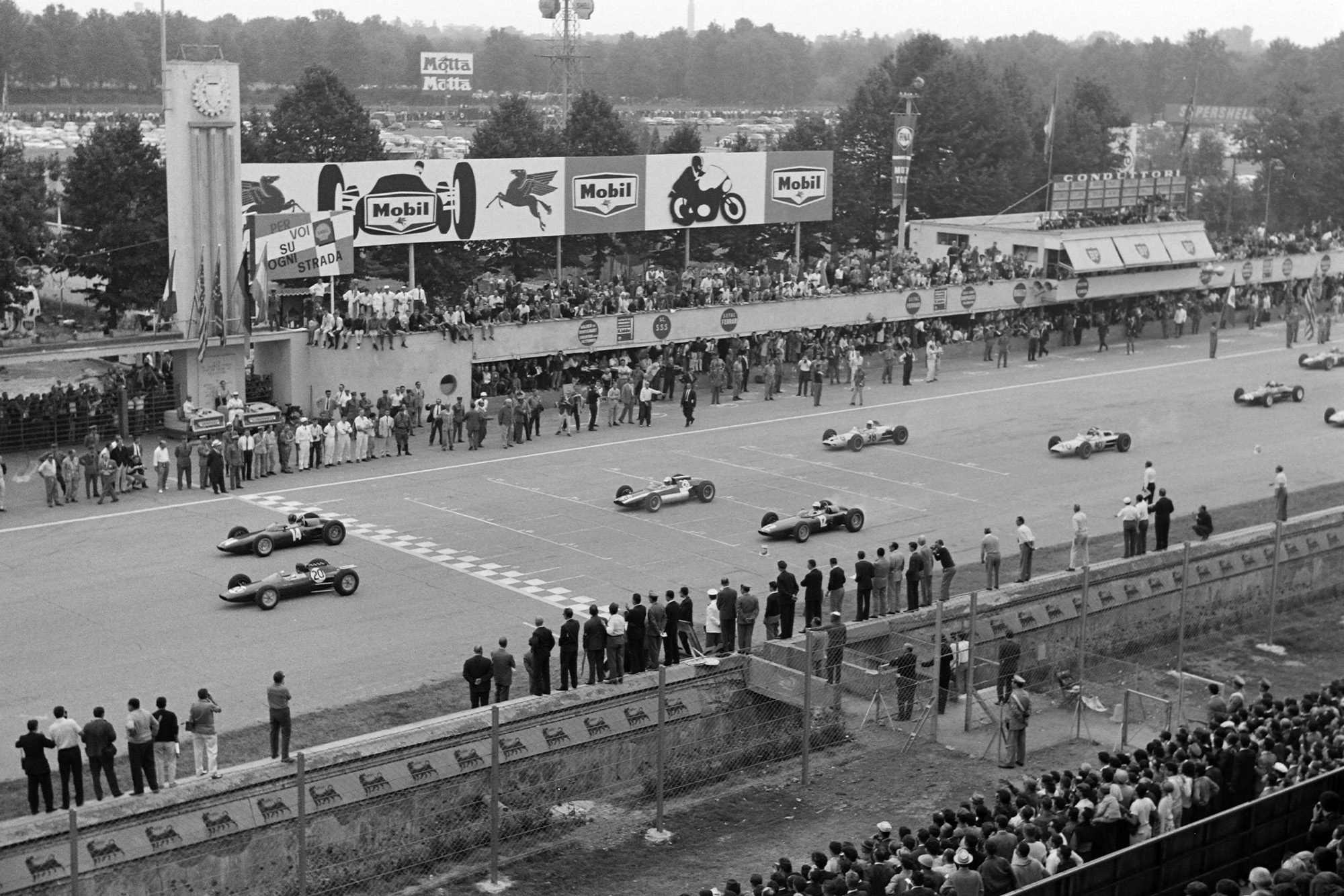 Clark and Hill lead the field away at the race start