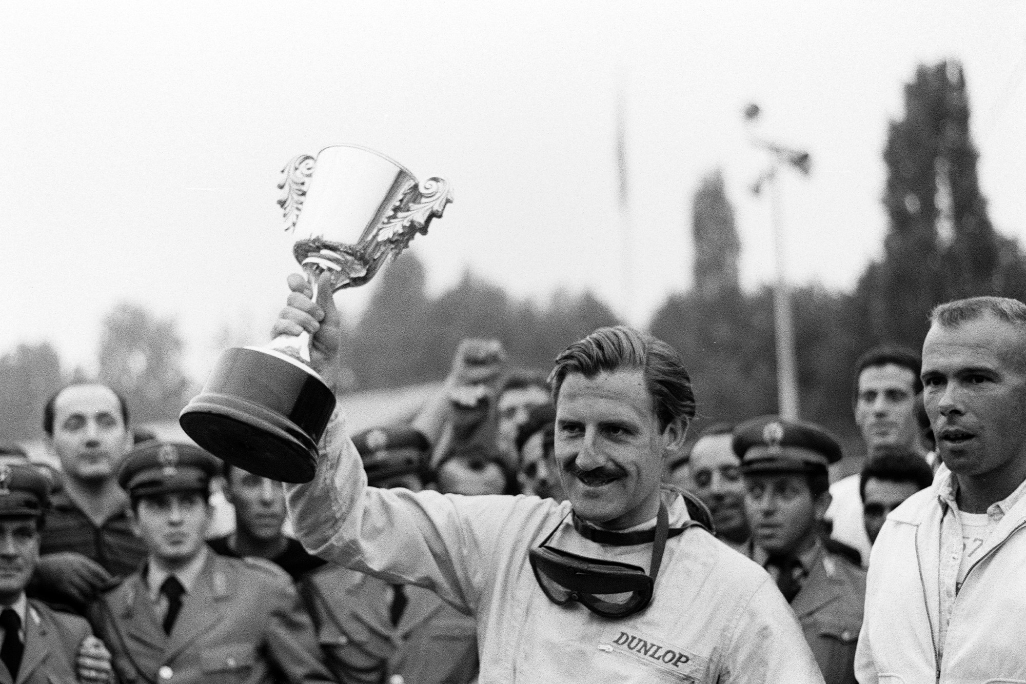 Hill lifts the winner's trophy for the third time that season