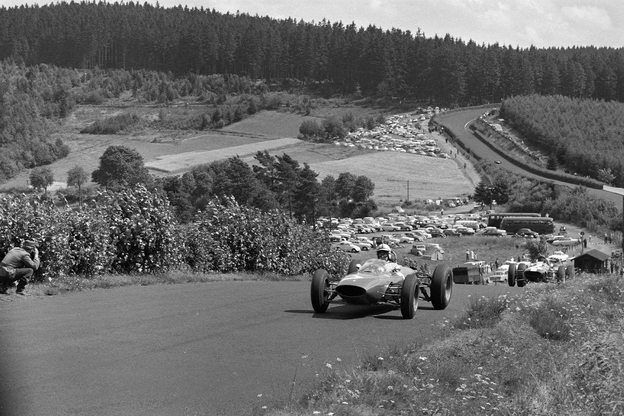 John Surtees, Ferrari 156/63, leads Jim Clark, Lotus 25 Climax.