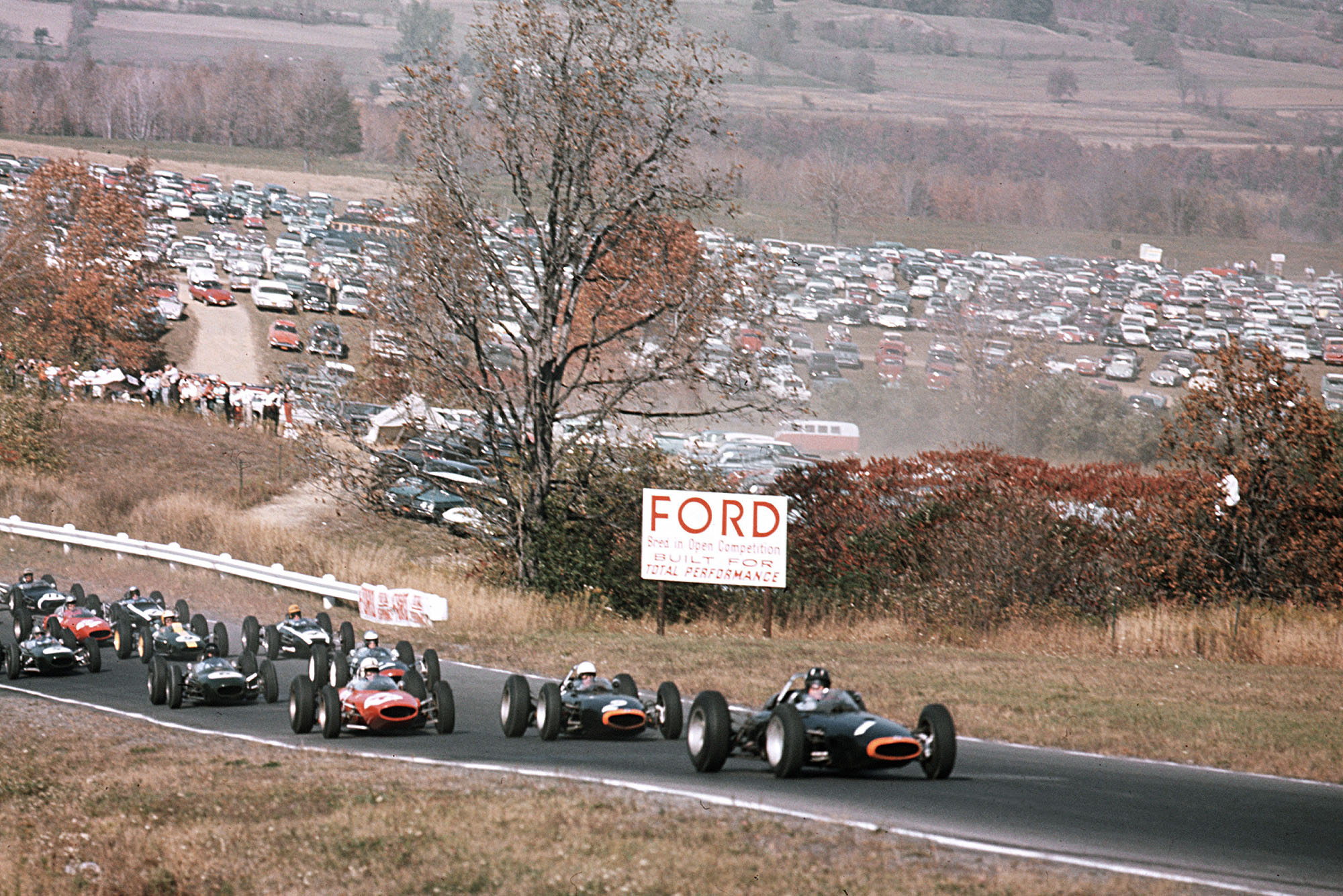 Graham Hill (BRM P57) leads team mate Richie Ginther (BRM P57) and John Surtees (Ferrari 156) at the start.