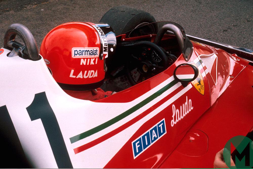 Niki Lauda prepares for the 1977 South African GP in his Ferrari