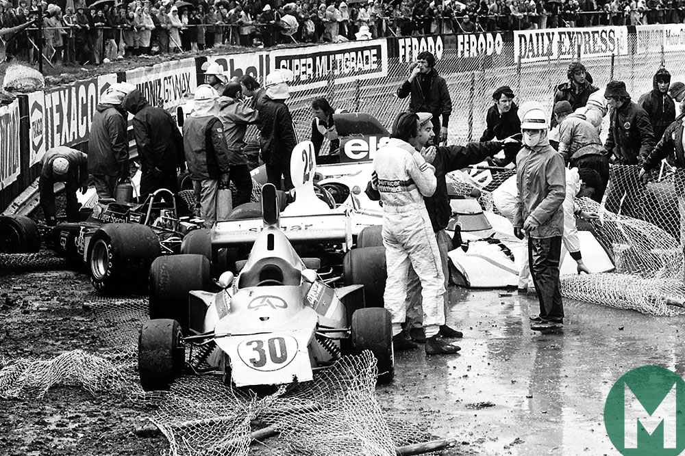 Crashed cars pile up at Club corner late in the 1975 British Grand Prix