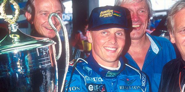 Johnny Herbert's Benetton takes the flag in the 1995 British Grand Prix