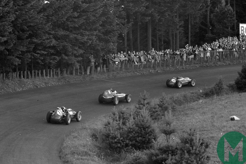 Brooks gets between the two Ferraris of Peter Collins and Mike Hawthorn
