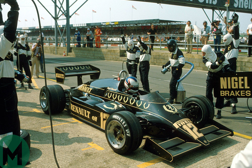 Nigel Mansell exits the pits in his Lotus 94T in the 1983 British Grand Prix