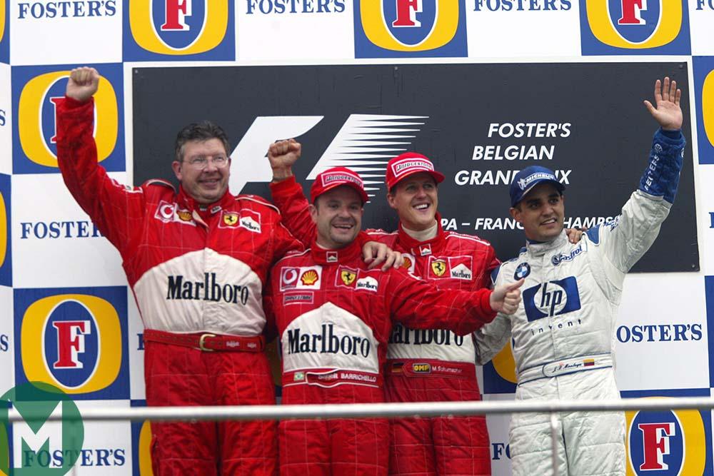 Ross Brawn on the Spa podium with 2002 Belgian Grand Prix-winner Michael Schumacher, 2nd-placed Rubens Barrichello and Juan Pablo Montoya, third,