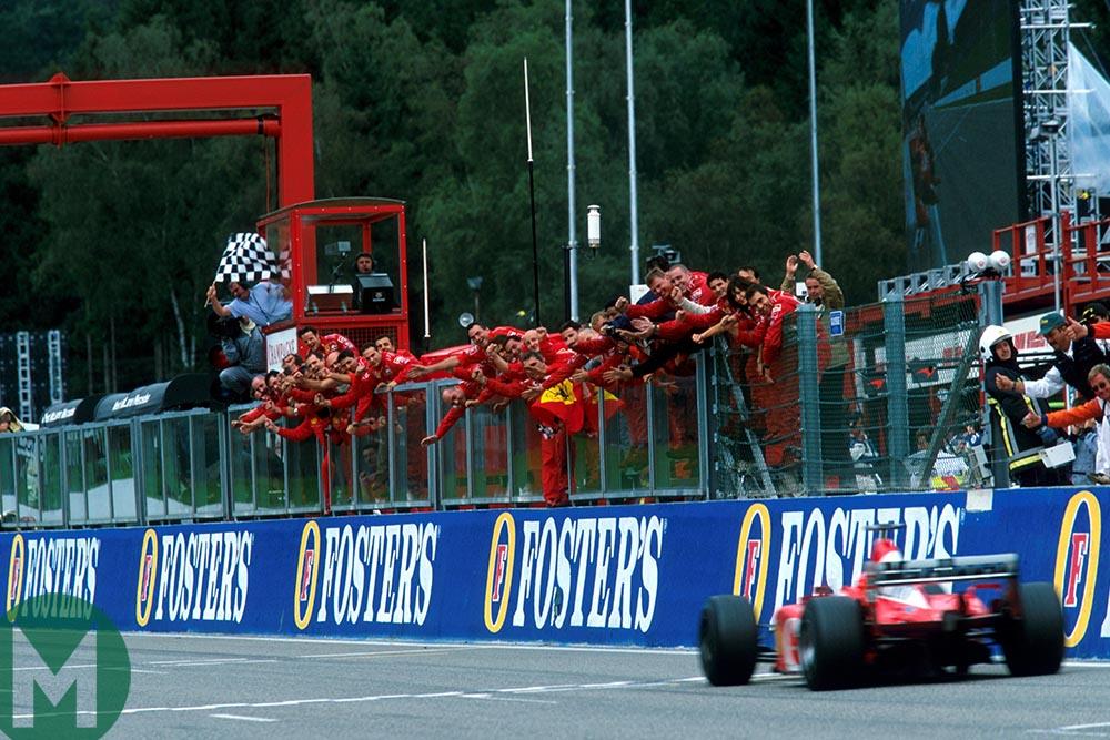 Michael Schumacher crosses the finish line to win the 2002 Belgian Grand Prix