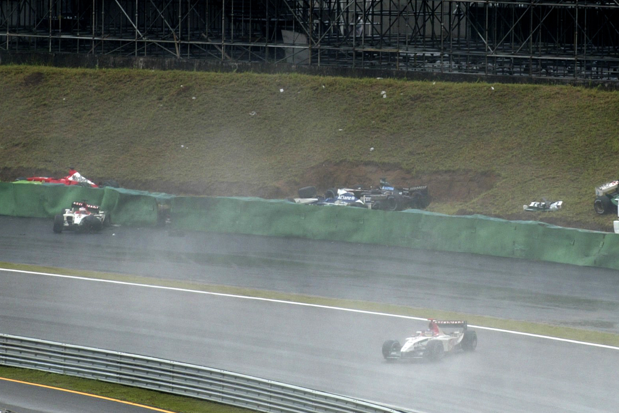 Cars aquaplane off the track during the 2003 Brazilian Grand Prix