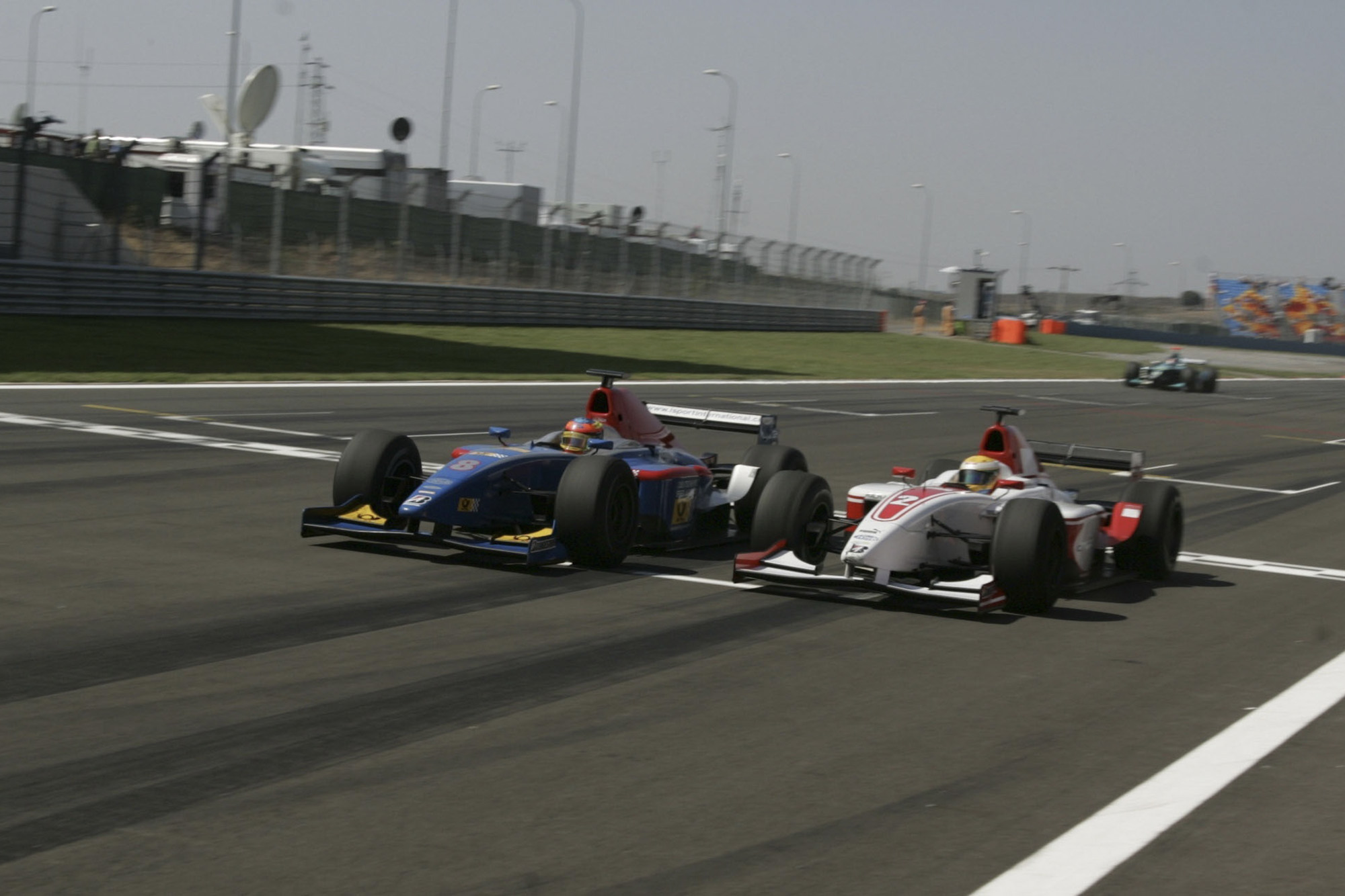 Lewis Hamilton and Timo Glock battle side by side at the 2006 GP2 race in Istanbul