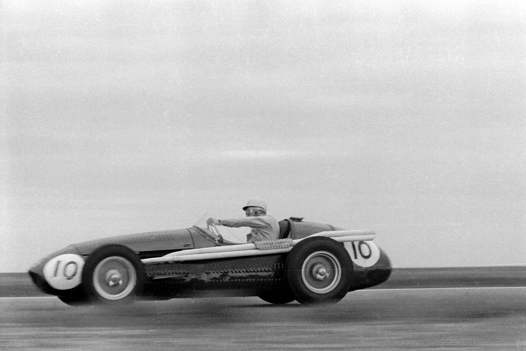 Stirling Moss at speed in a Maserati 250F in the Glover Trophy at Goodwood