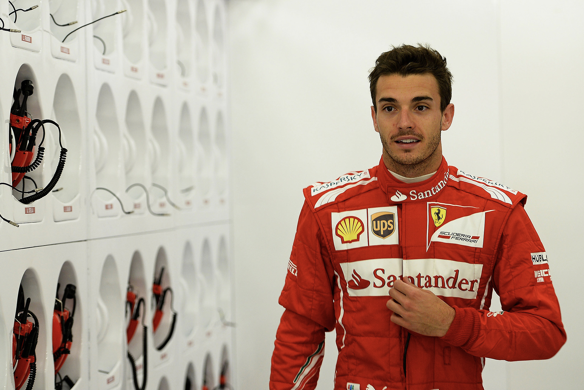 Jules BIanchi in Ferrari overalls at a 2014 F1 test at Silverstone