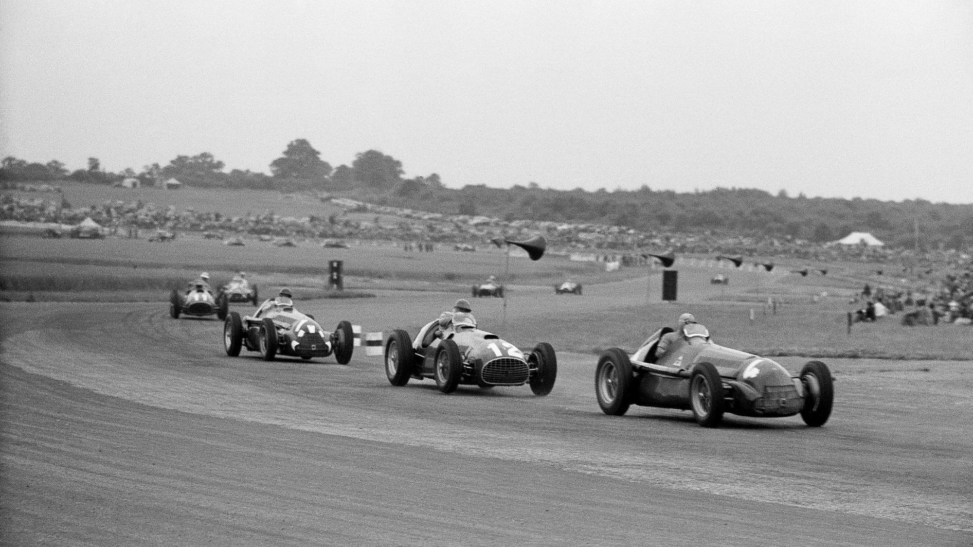 Felice Bonetto leads Jose Froilan Gonzalez Giuseppe Farina Alberto Ascari and Juan Manuel Fangio at the start of the 1951 British Grand Prix at Silverstone