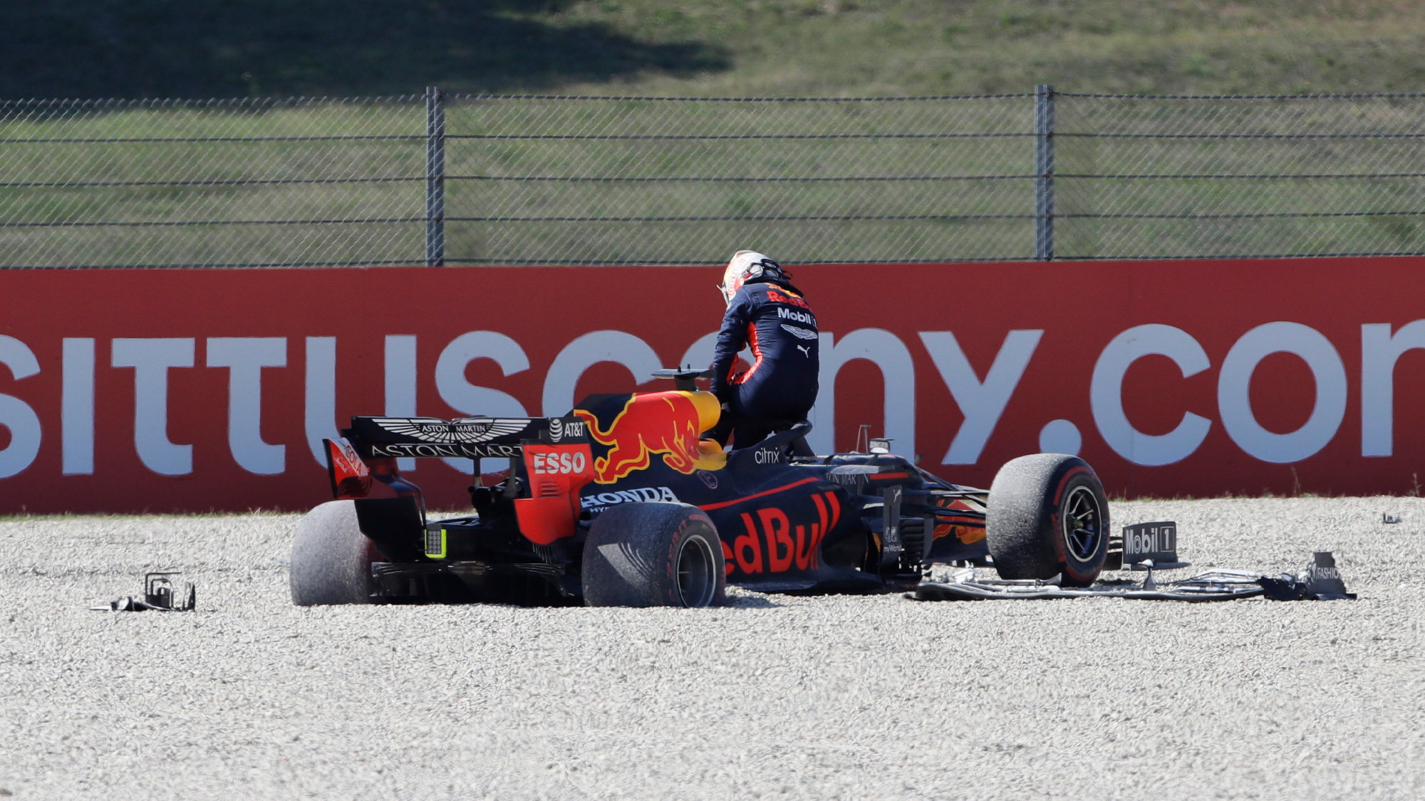 Max Verstappen climbs out of his Red Bull after crashing out of the 2020 F1 TUscan Grand Prix at Mugello