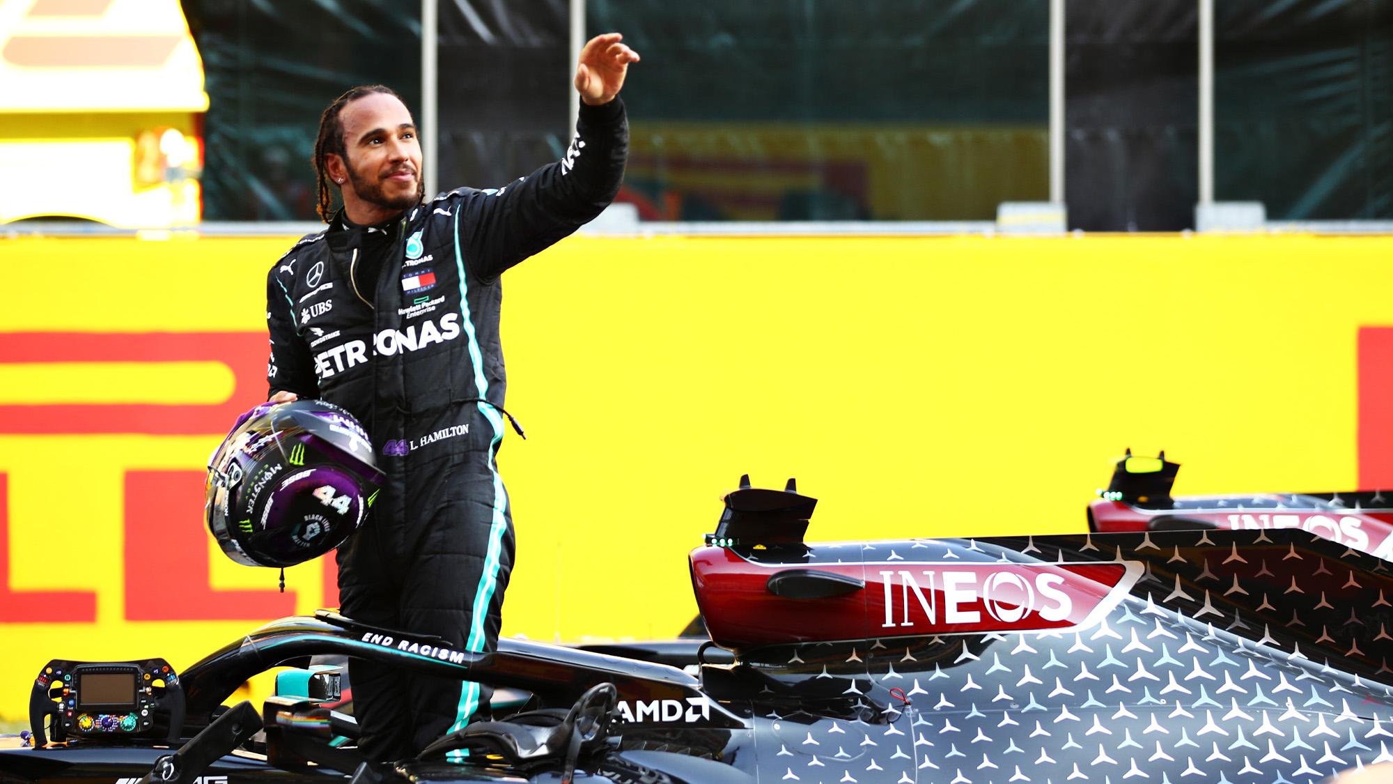 Lewis Hamilton raises his arm after winning the 2020 Tuscan Grand Prix at Mugello