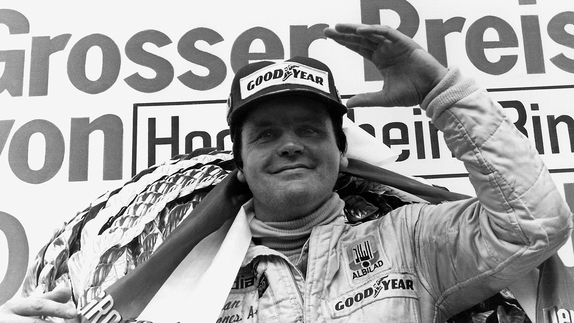 Alan Jones on the podium for Williams after the 1979 F1 German Grand prix