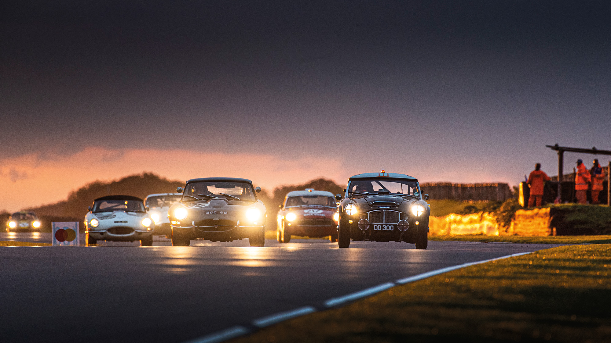 Stirling Moss Memorial Trophy race in the dusk at Goodwood SpeedWeek