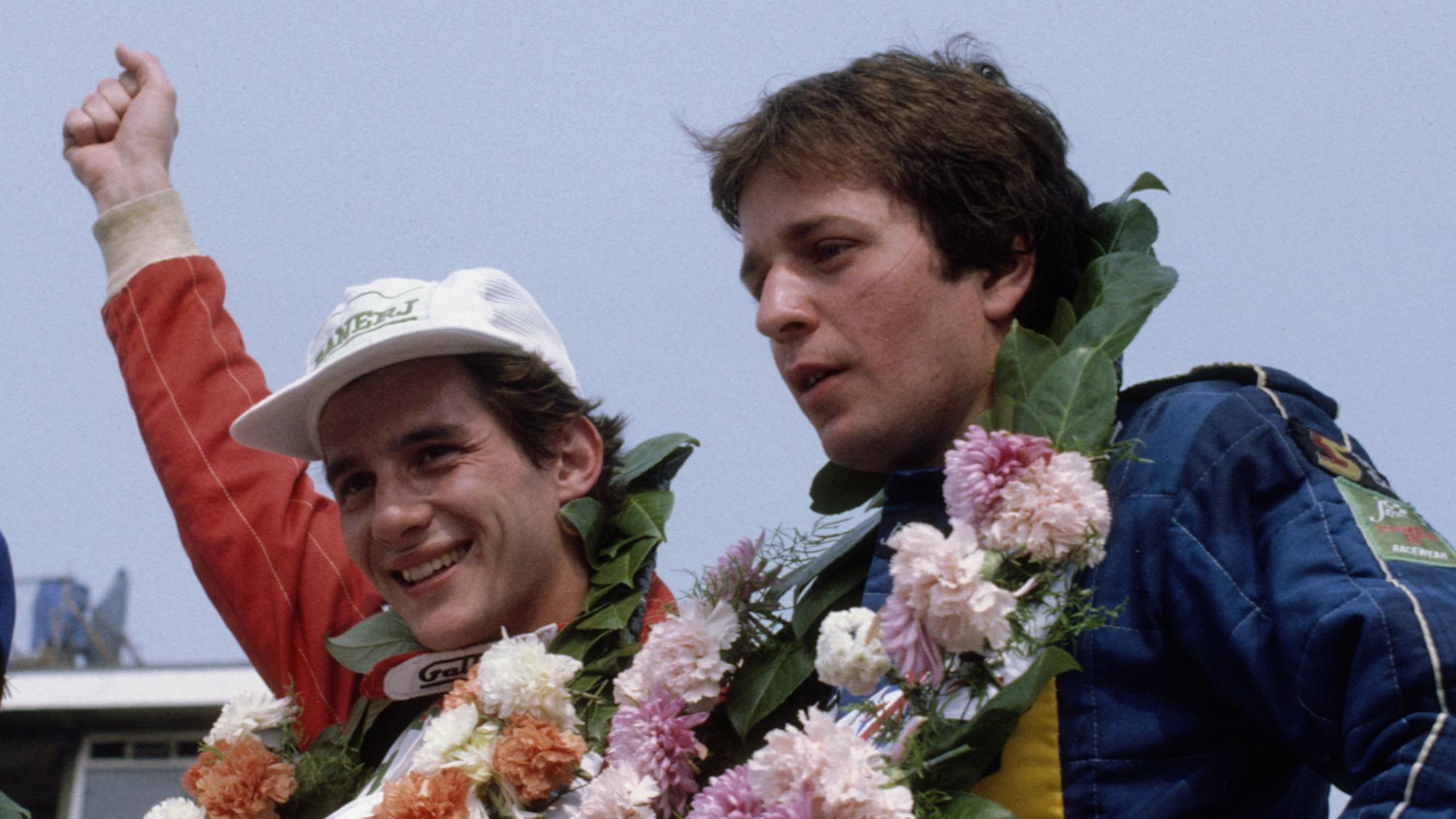 Ayrton Senna celebrates winning the 1983 British F3 championship at Silverstone next to Martin Brundle